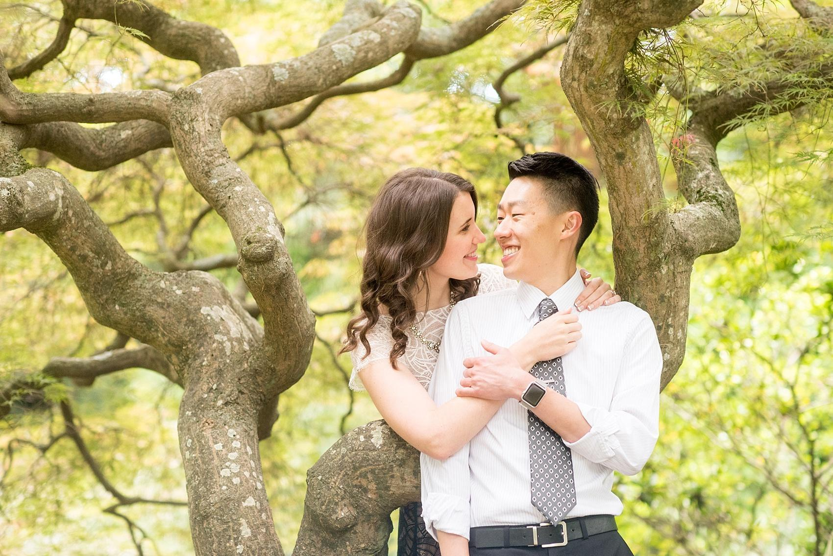 Raleigh North Carolina wedding photographer, Mikkel Paige Photography, photographs a playful engagement session at Raulston Arboretum at NC State campus.