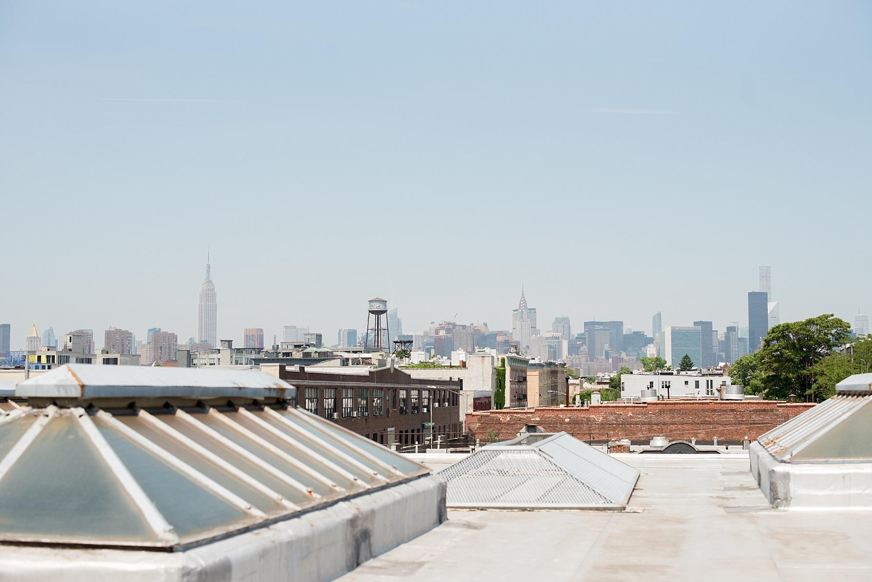 Mikkel Paige Photography, NYC wedding photographer, captures Brooklyn event space, Dobbin St. with NYC skyline view from the large rooftop.