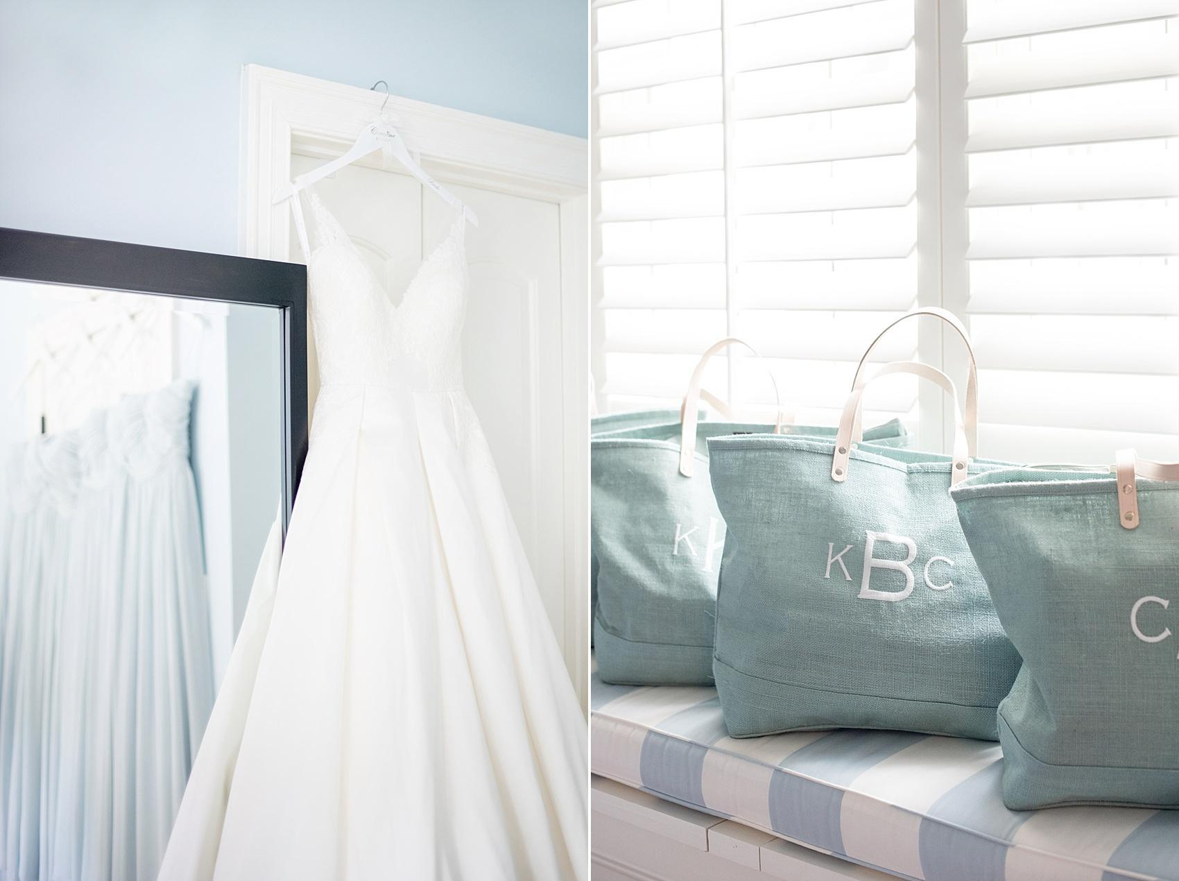 Mikkel Paige Photography captures the bride's Alyne wedding gown, Eleanor style. Bridesmaids monogrammed blue totes from Ballard Designs. Market Hall event in downtown Raleigh, NC.