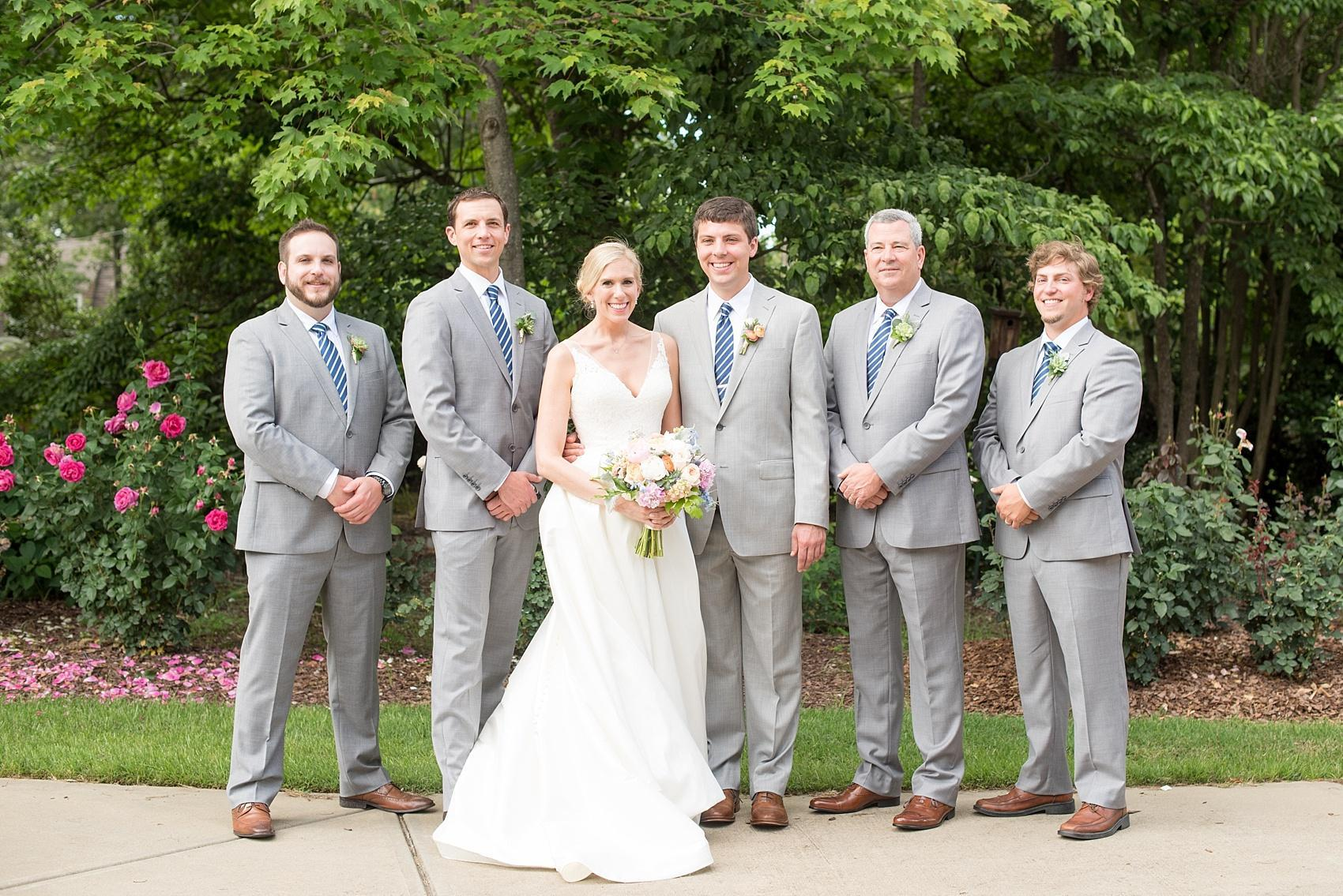 Mikkel Paige Photography photos of a downtown Raleigh Market Hall wedding with spring pictures of the bride and groomsmen.