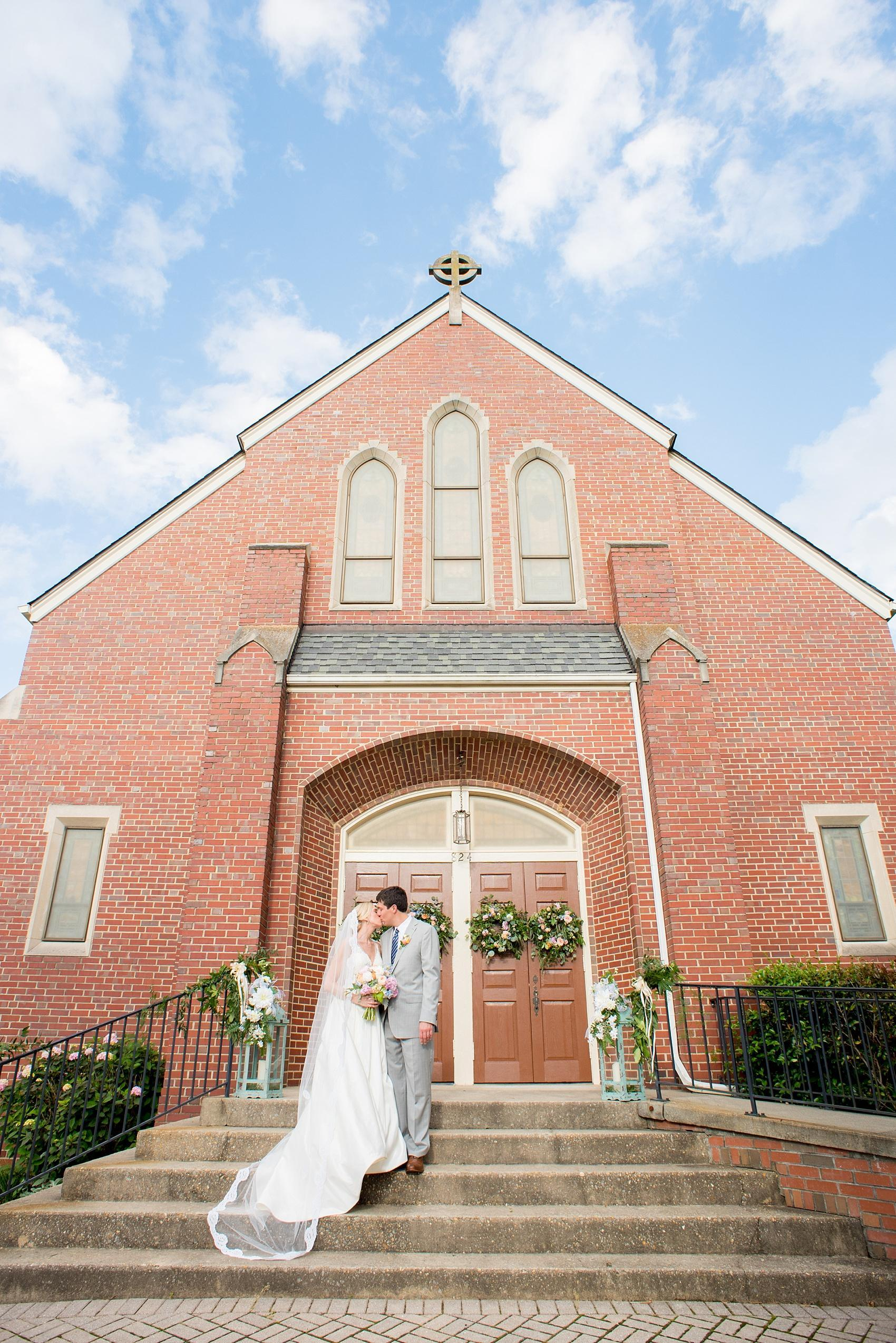 Mikkel Paige Photography photos of a downtown Raleigh wedding with pictures of the bride and groom at Trinity church.