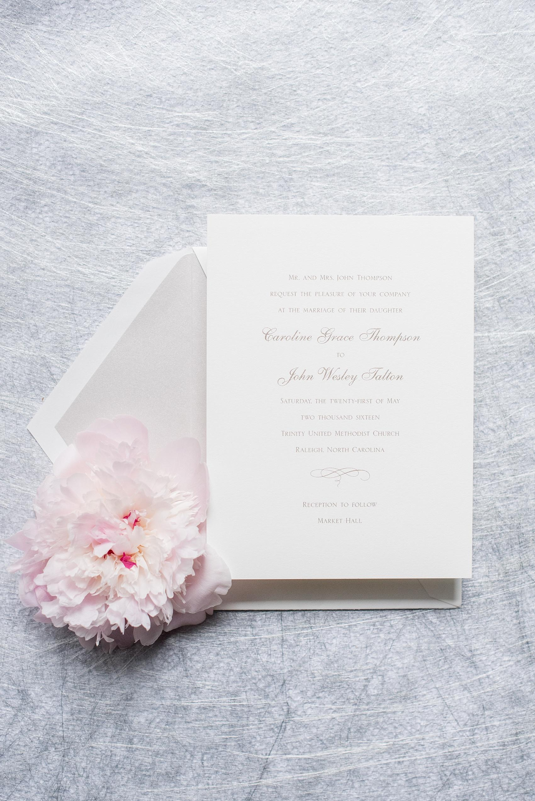 Mikkel Paige Photography photos of a downtown Raleigh Market Hall wedding with pictures of the simple white and silver invitation from If It's Paper.