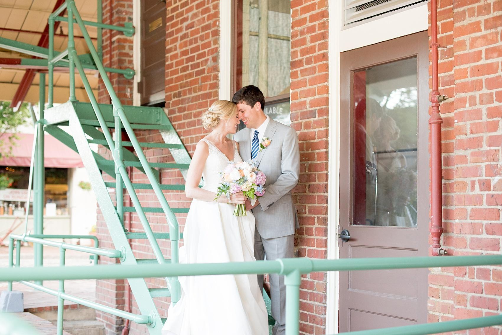 Mikkel Paige Photography photos of a downtown Raleigh Market Hall wedding with pictures of the bride and groom.