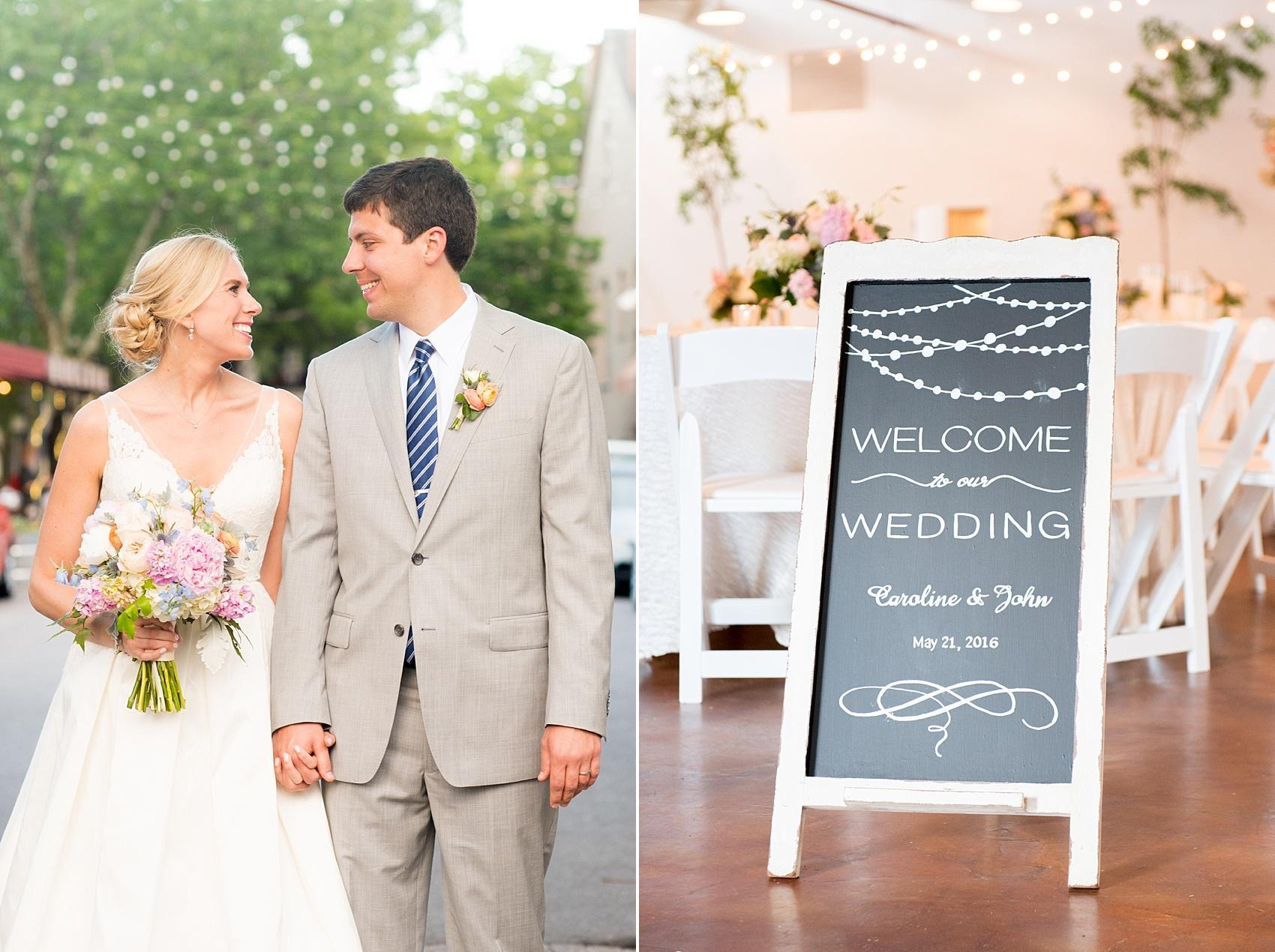 Mikkel Paige Photography photos of a downtown Raleigh Market Hall wedding with pictures of the bride and groom and bistro lights and custom chalkboard welcome sign from AB Chalk Designs.