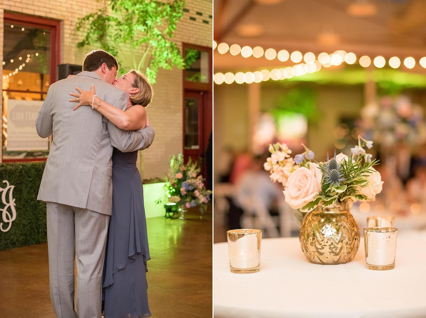 Mikkel Paige Photography photos of a wedding in downtown Raleigh at Market Hall, North Carolina. Special mother son dance and bistro light high top tables and small floral centerpieces in mercury glass.
