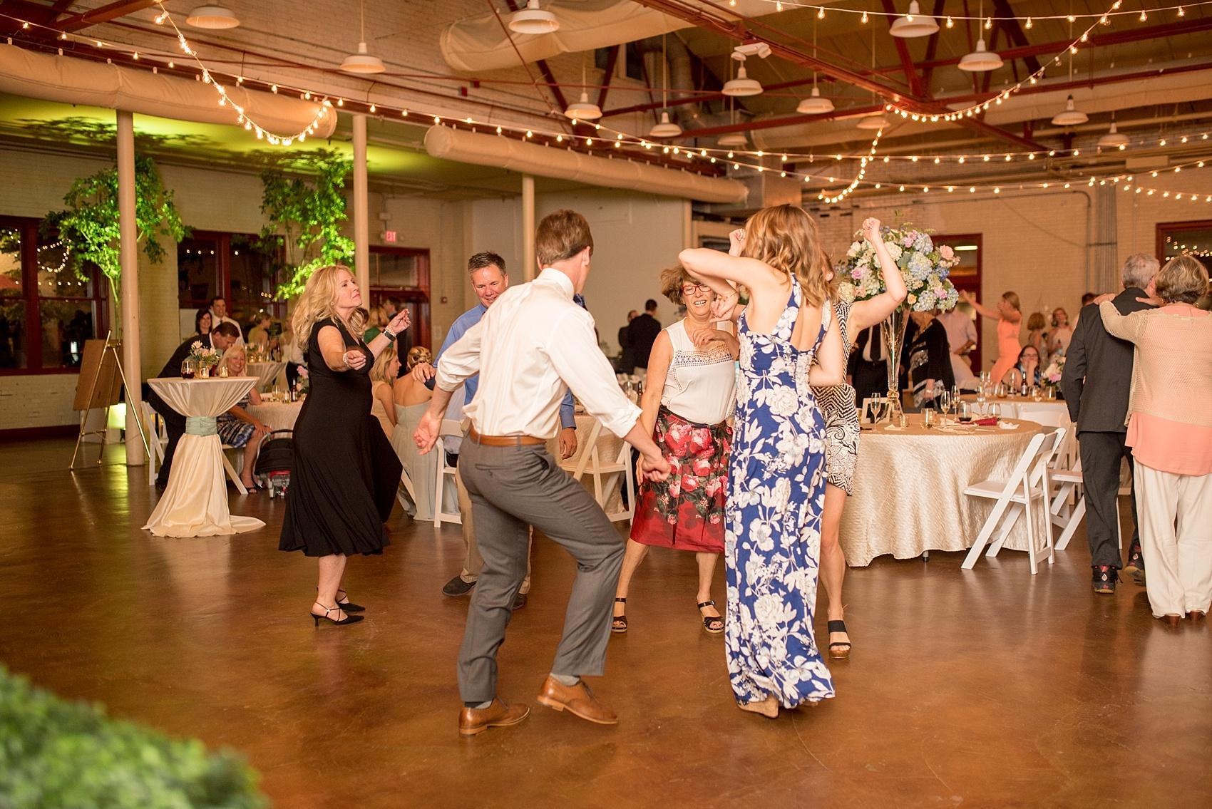 Mikkel Paige Photography photos of a wedding in downtown Raleigh at Market Hall, North Carolina. Dance floor time!