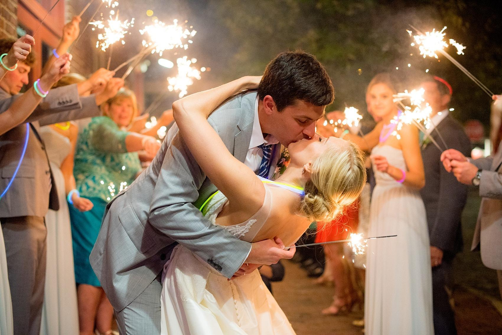 Mikkel Paige Photography photos of a wedding in downtown Raleigh at Market Hall, North Carolina. Sparkler sendoff for the couple's exit!