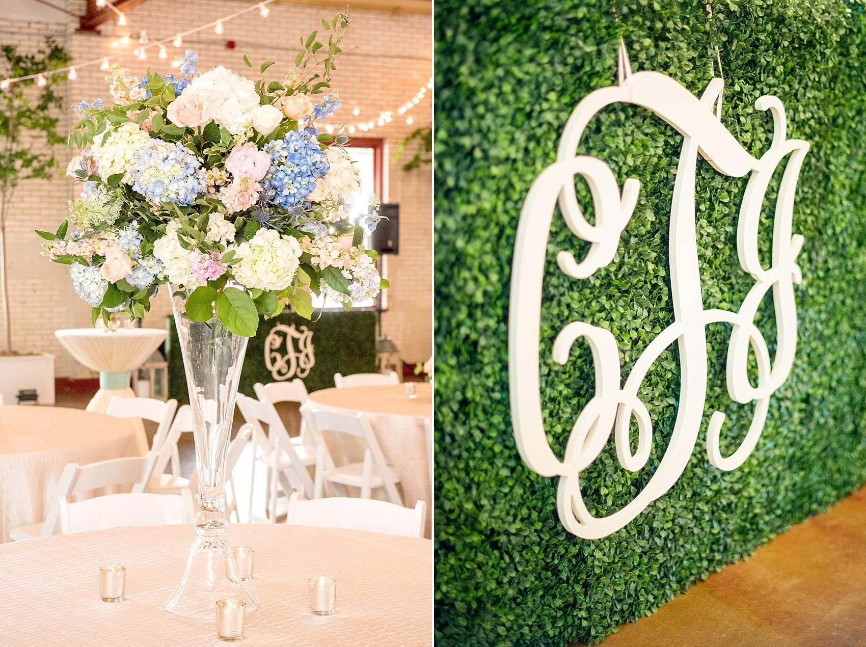Mikkel Paige Photography photos of a downtown Raleigh Market Hall wedding with their custom laser cut monogram and floral centerpieces with hydrangea and roses.