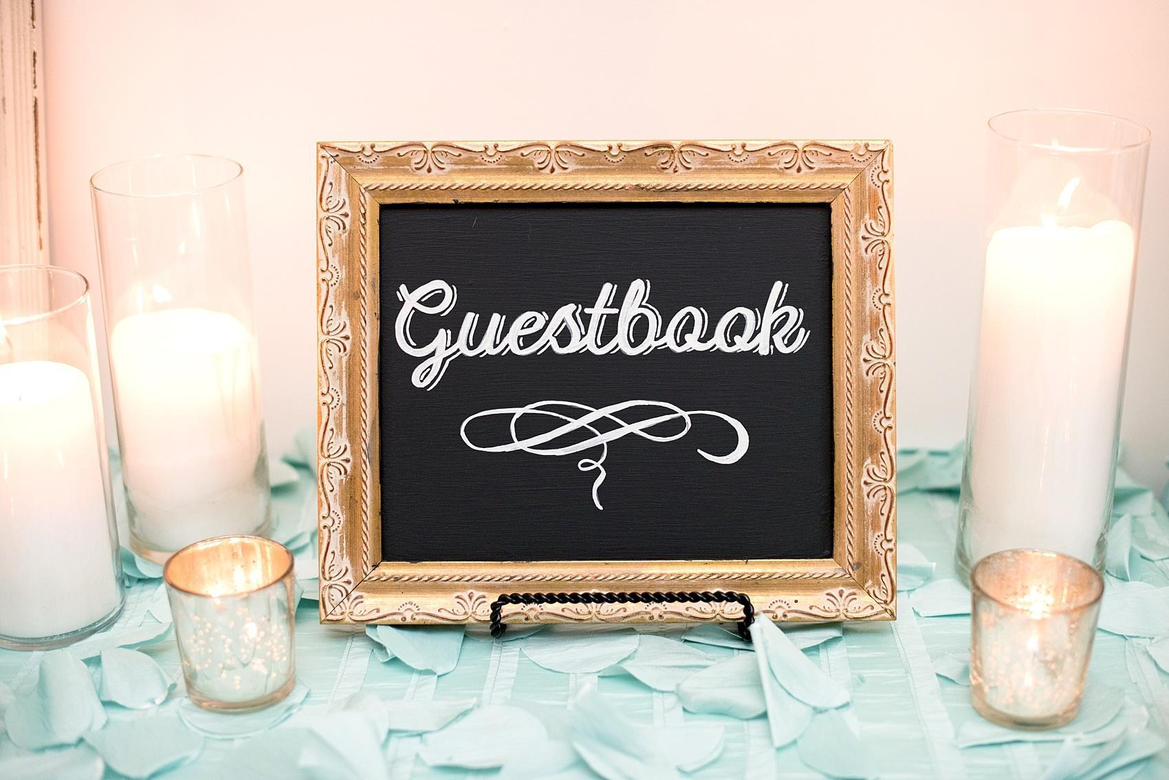 Mikkel Paige Photography photos of a downtown Raleigh Market Hall wedding with custom chalkboard guestbook sign.