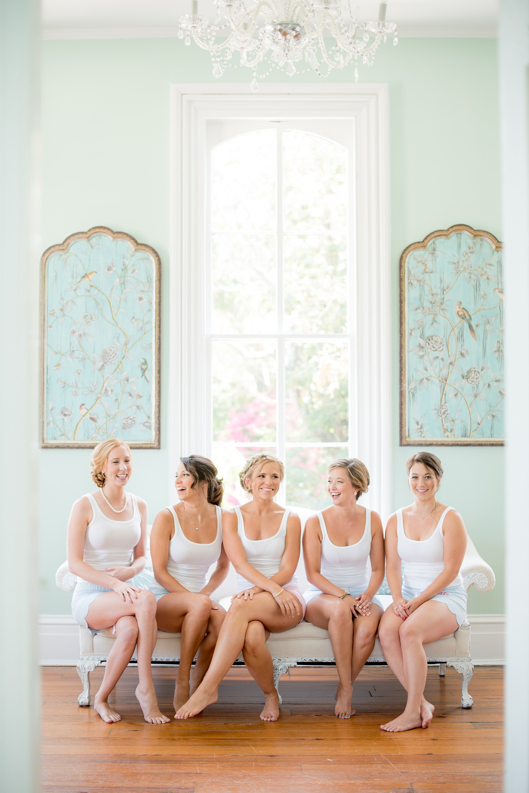 Mikkel Paige Photography wedding photos at The Merrimon-Wynne House in downtown Raleigh. The bridal party gets ready in matching outfits with monogrammed seersucker shorts from the bride.