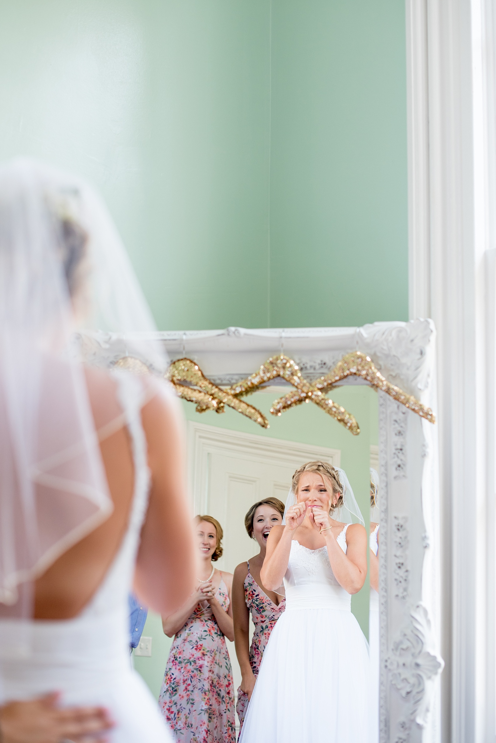 Mikkel Paige Photography wedding photos at The Merrimon-Wynne House in downtown Raleigh. The bride gets ready with her bridal party and sees herself in the mirror for the first time.