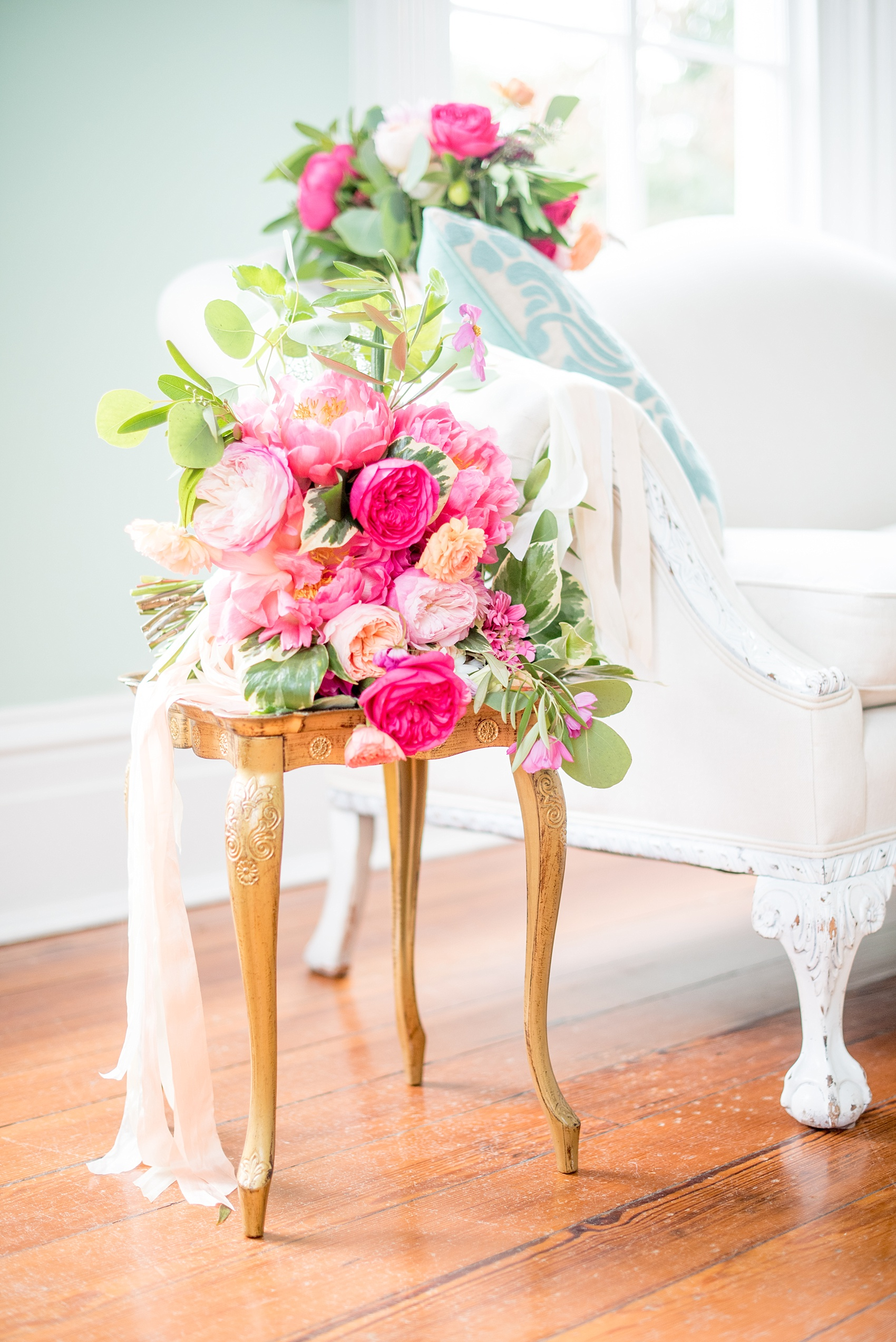 Mikkel Paige Photography wedding photos at The Merrimon-Wynne House in downtown Raleigh. Colorful pink, orange and green bouquets with peonies, eucalyptus and garden roses by Meristem Floral.