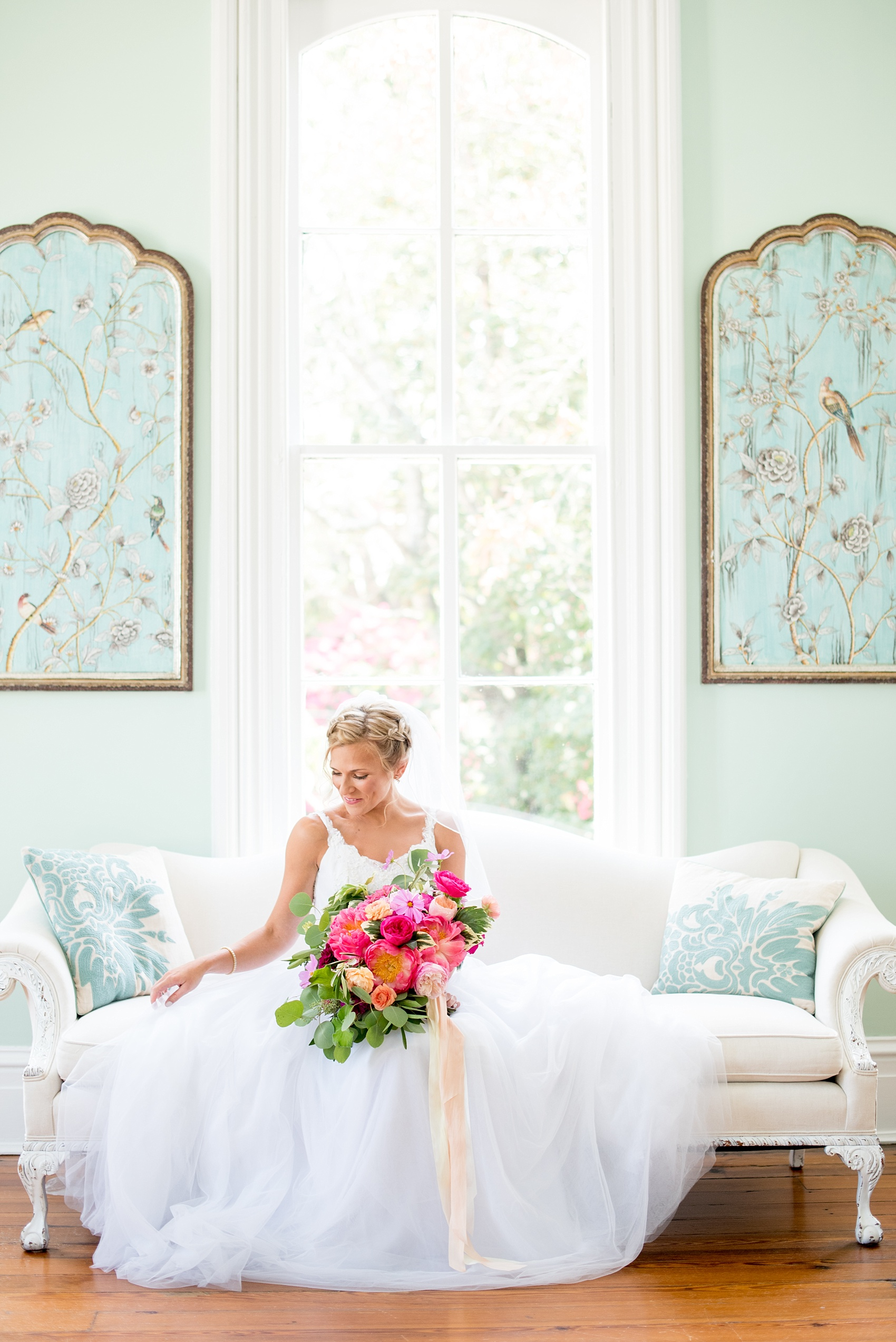 Mikkel Paige Photography wedding photos at The Merrimon-Wynne House in downtown Raleigh. A bridal portrait with the bride's tulle skirt and colorful bouquet by Meristem Floral.