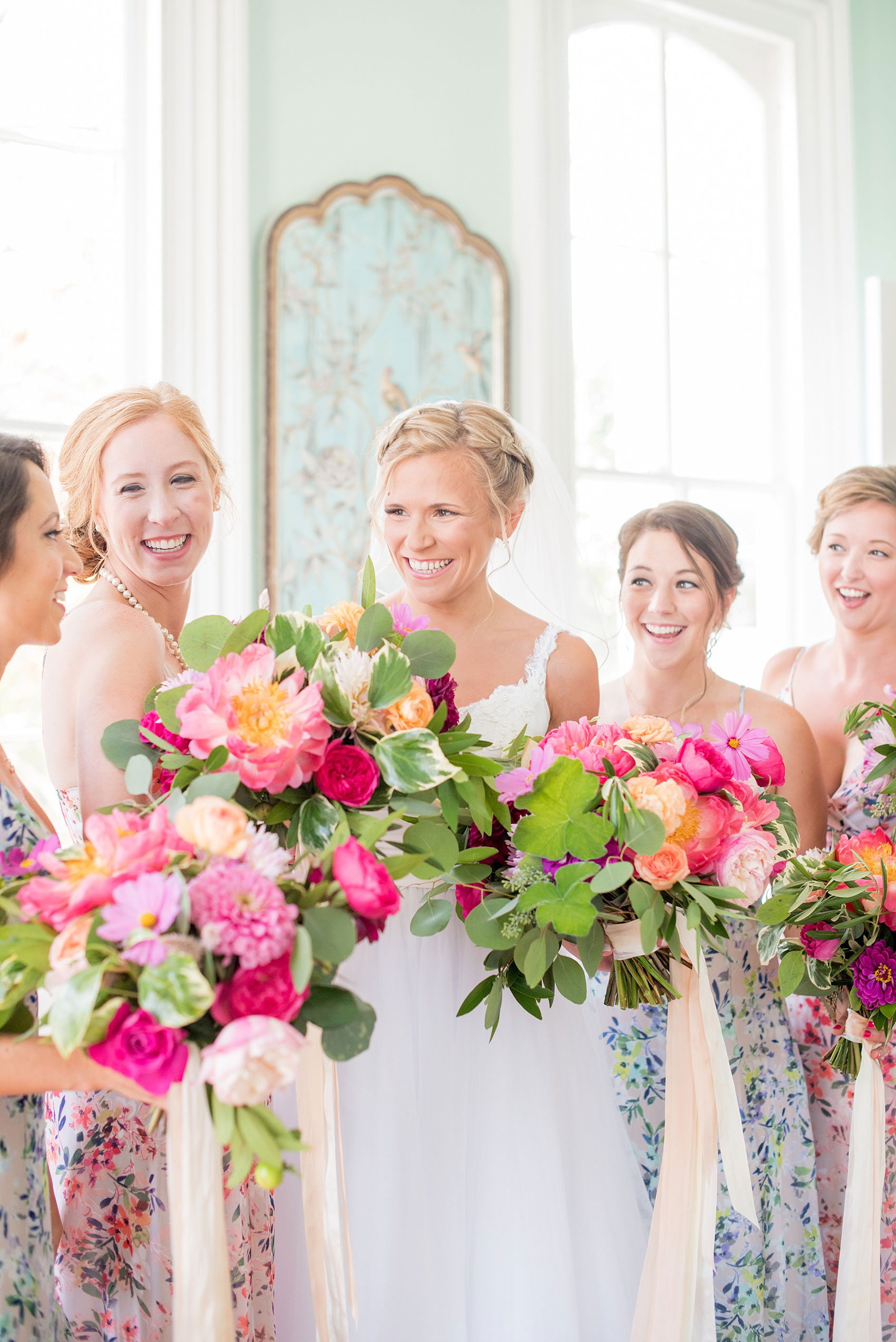 Mikkel Paige Photography wedding photos at The Merrimon-Wynne House in downtown Raleigh. Bridal party in floral maxi dresses in blue and pink and colorful garden rose and peony bouquets.