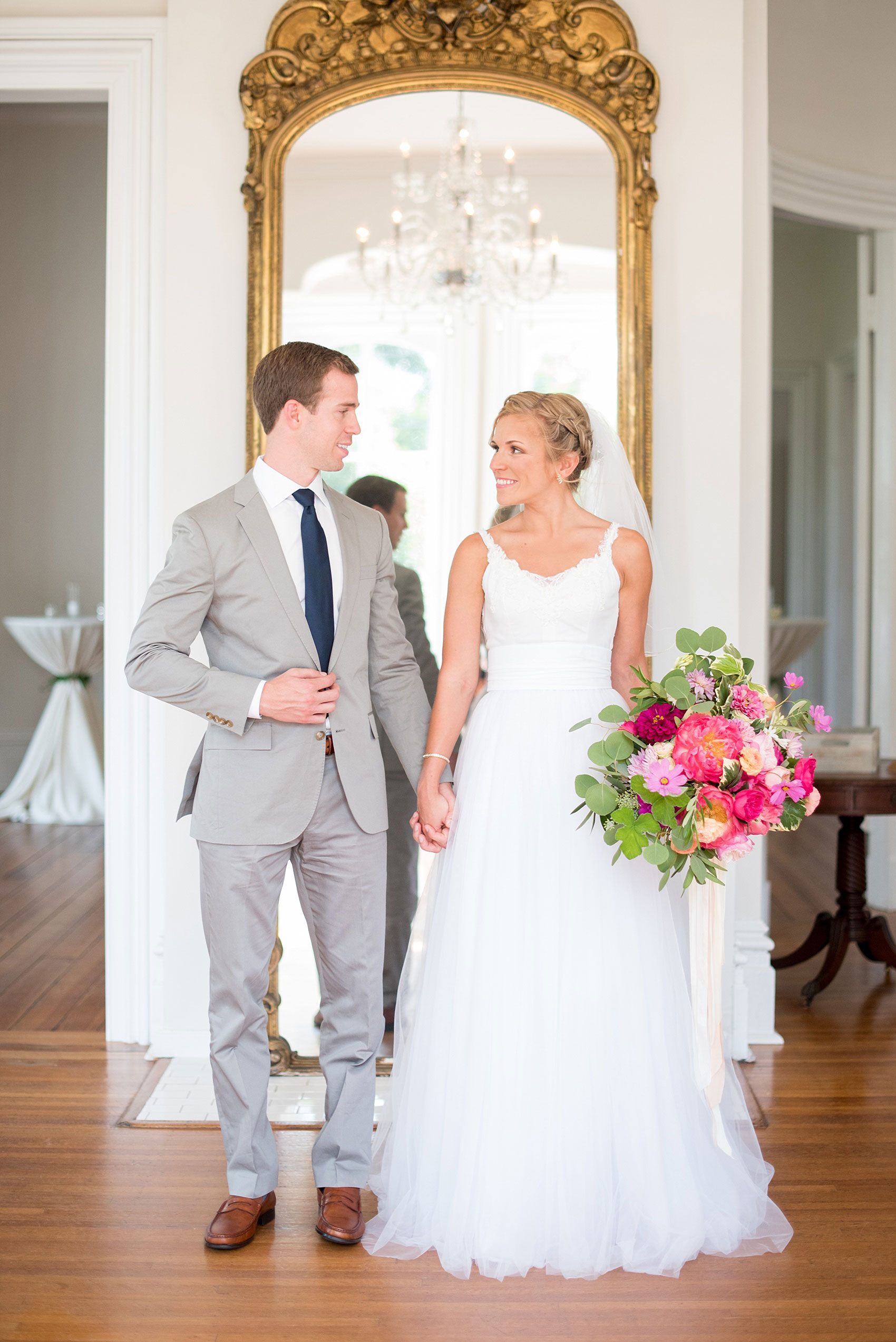 Mikkel Paige Photography wedding photos at The Merrimon-Wynne House in downtown Raleigh. The bride and groom with colorful bouquet and tulle skirt wedding dress.