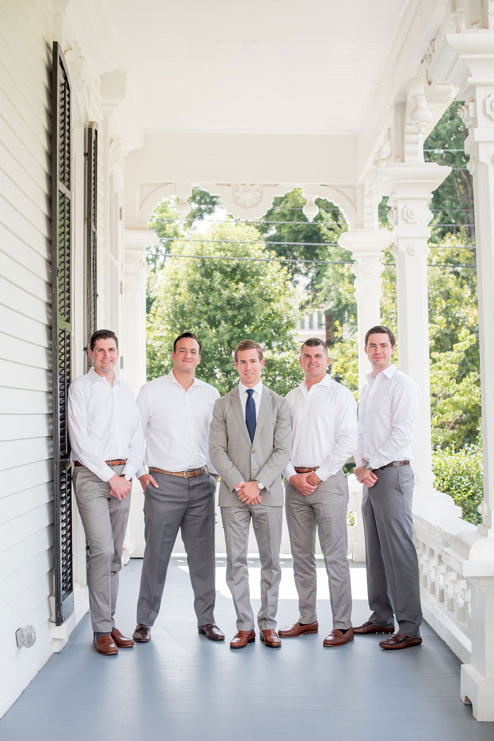 Mikkel Paige Photography wedding photos at The Merrimon-Wynne House in downtown Raleigh. The groom and his groomsmen in unique outfits - no tie and no jacket - for a summer wedding in the south.