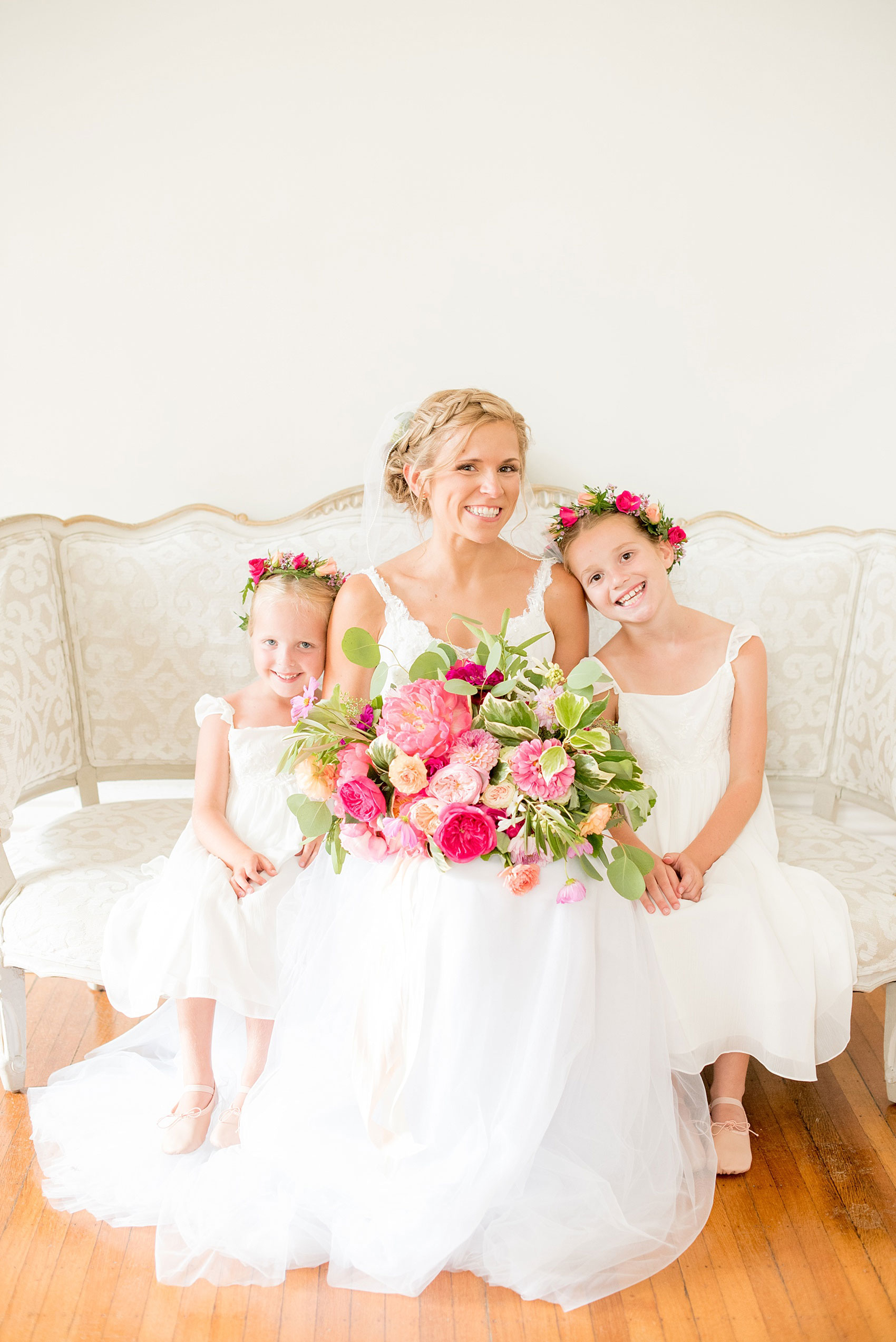 Mikkel Paige Photography wedding photos at The Merrimon-Wynne House in downtown Raleigh. The bride with her two flower girls in colorful floral crowns by Meristem Floral.