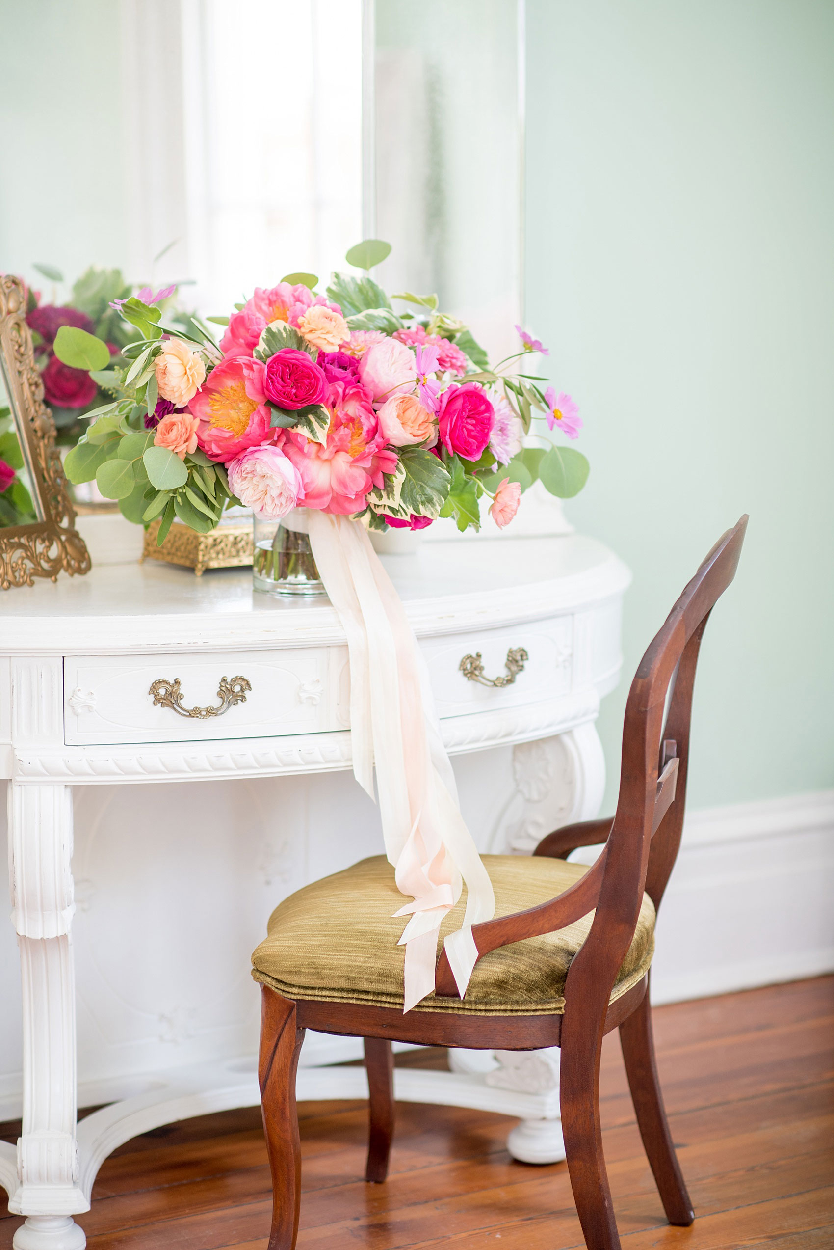 Mikkel Paige Photography wedding photos at The Merrimon-Wynne House in downtown Raleigh. The bride carried a colorful full bouquet with dahlias, garden roses, eucalyptus and peonies, complete with long silk ribbon wrap by Meristem Floral.