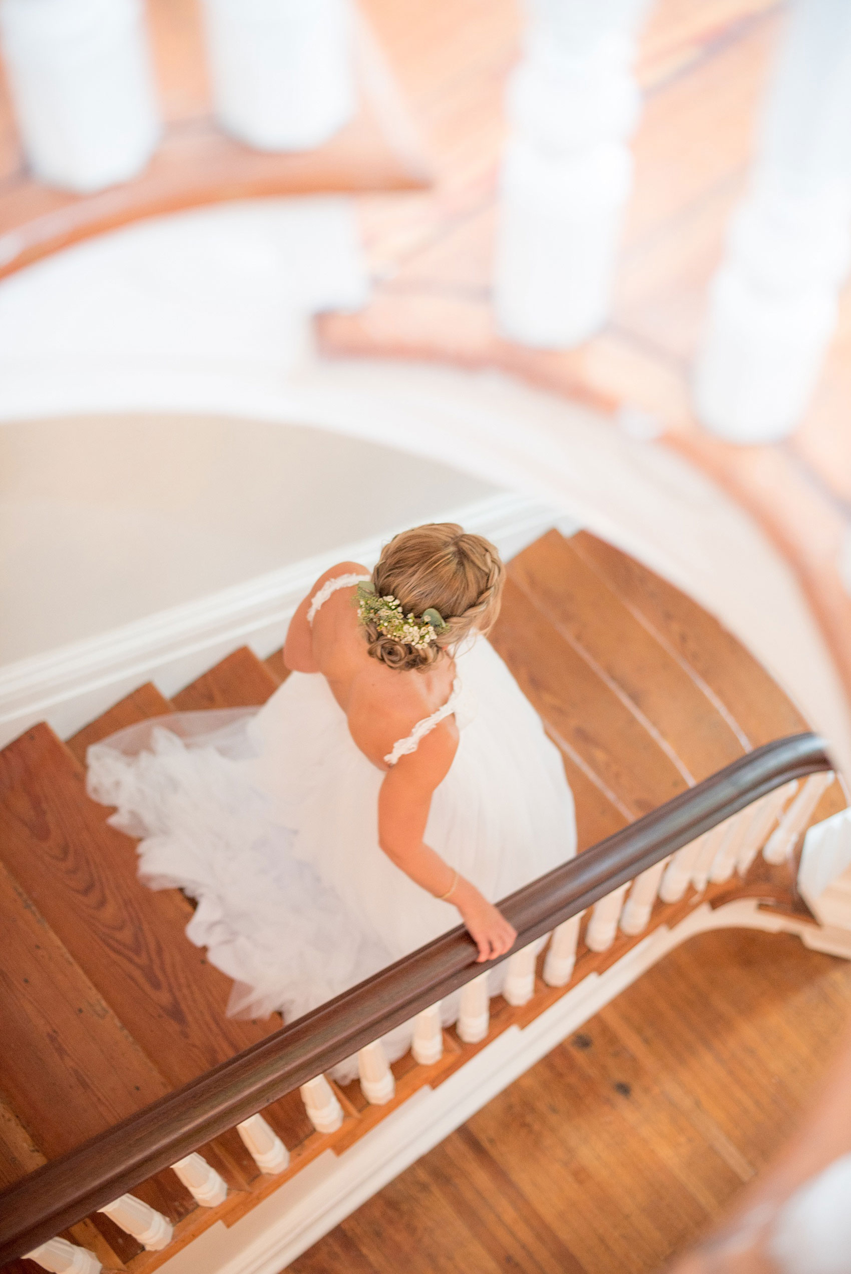 Mikkel Paige Photography wedding photos at The Merrimon-Wynne House in downtown Raleigh. An aerial view photo of the bride walking down the southern home's grand staircase.