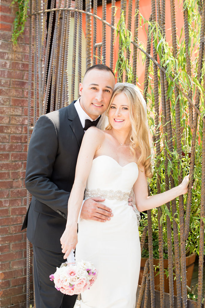 Mikkel Paige Photography photo of the bride and groom in front of their wedding at My Moon Brooklyn.