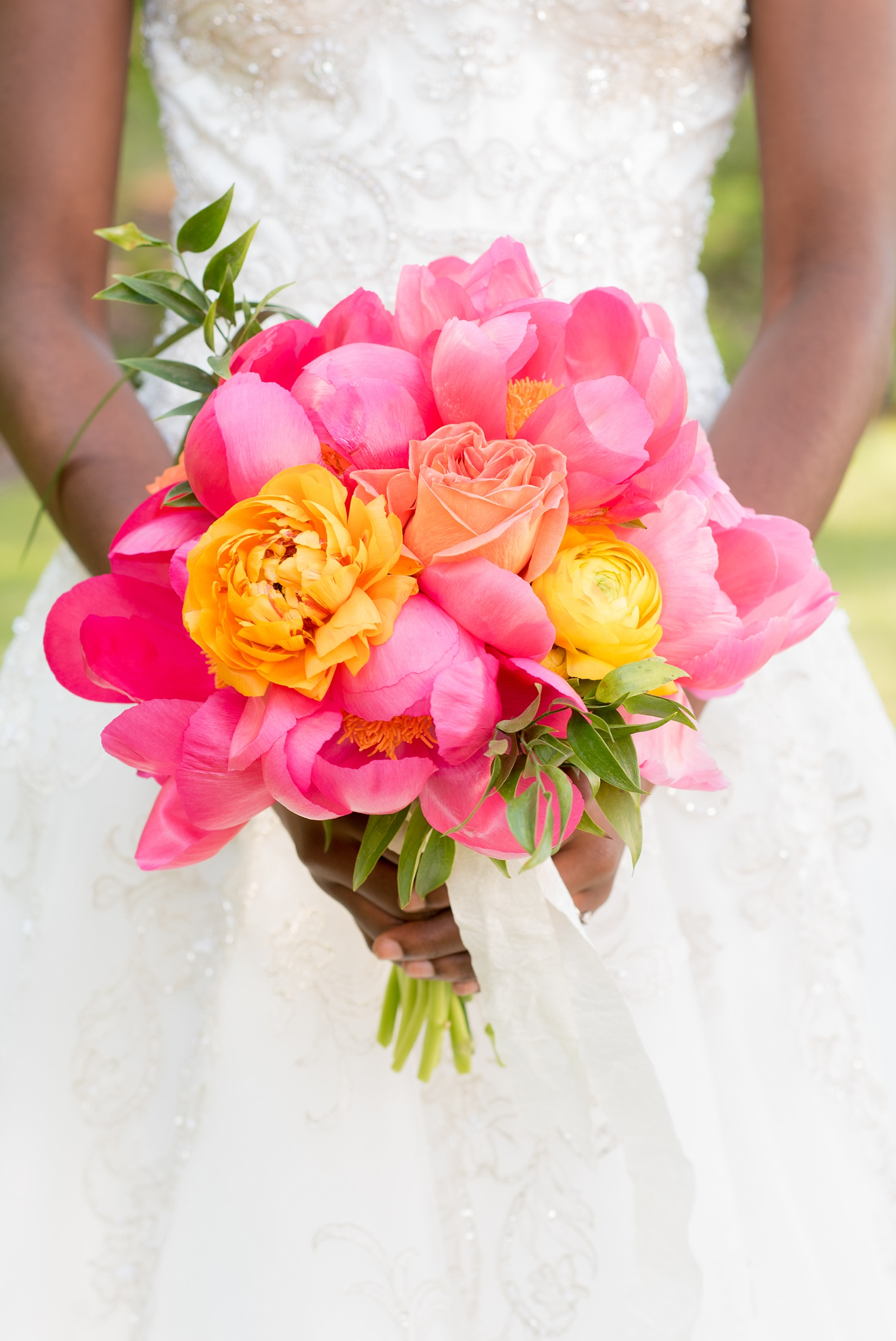 Mikkel Paige Photography wedding photo at The Bradford, NC. Bride's pink peony and yellow ranunculus bridal bouquet.
