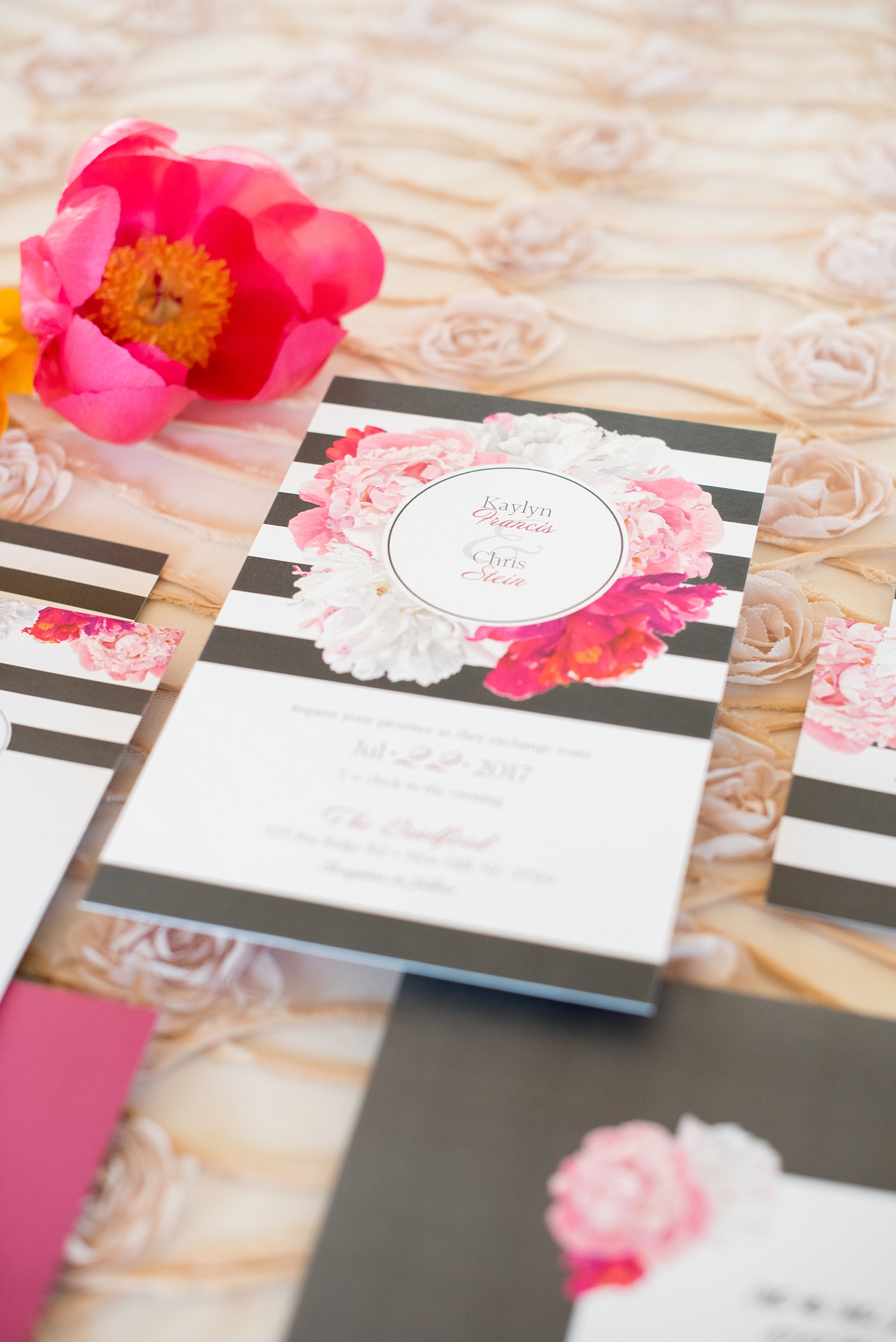 Mikkel Paige Photography wedding photo at The Bradford, NC. Modern pink, black and white striped invitation set.