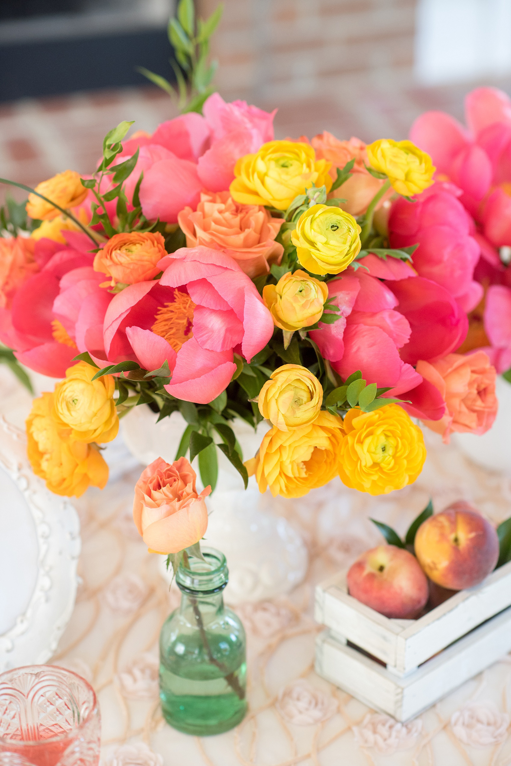 Mikkel Paige Photography wedding photo at The Bradford, NC. Modern pink, black and white table setup. Peonies and ranunculus and shabby chic peach holders.