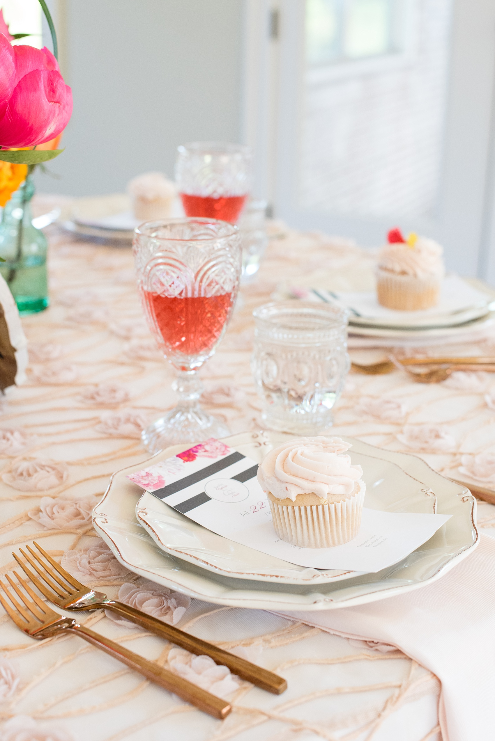 Mikkel Paige Photography wedding photo at The Bradford, NC. Modern pink, black and white table setup. Cupcake placed on top of the plate menu.