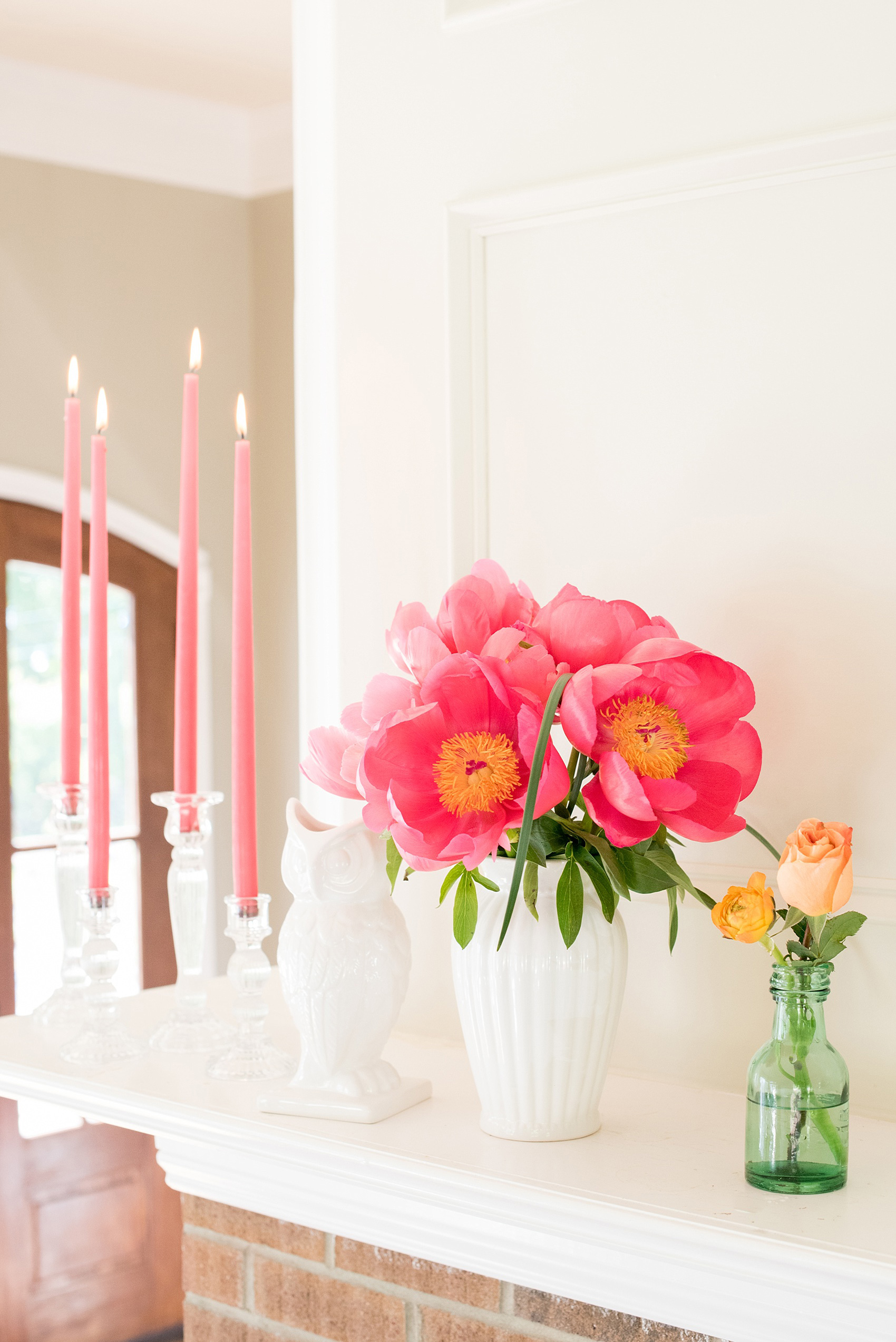 Mikkel Paige Photography wedding photo at The Bradford, NC. Pink candles and peonies adorn the fireplace mantle.