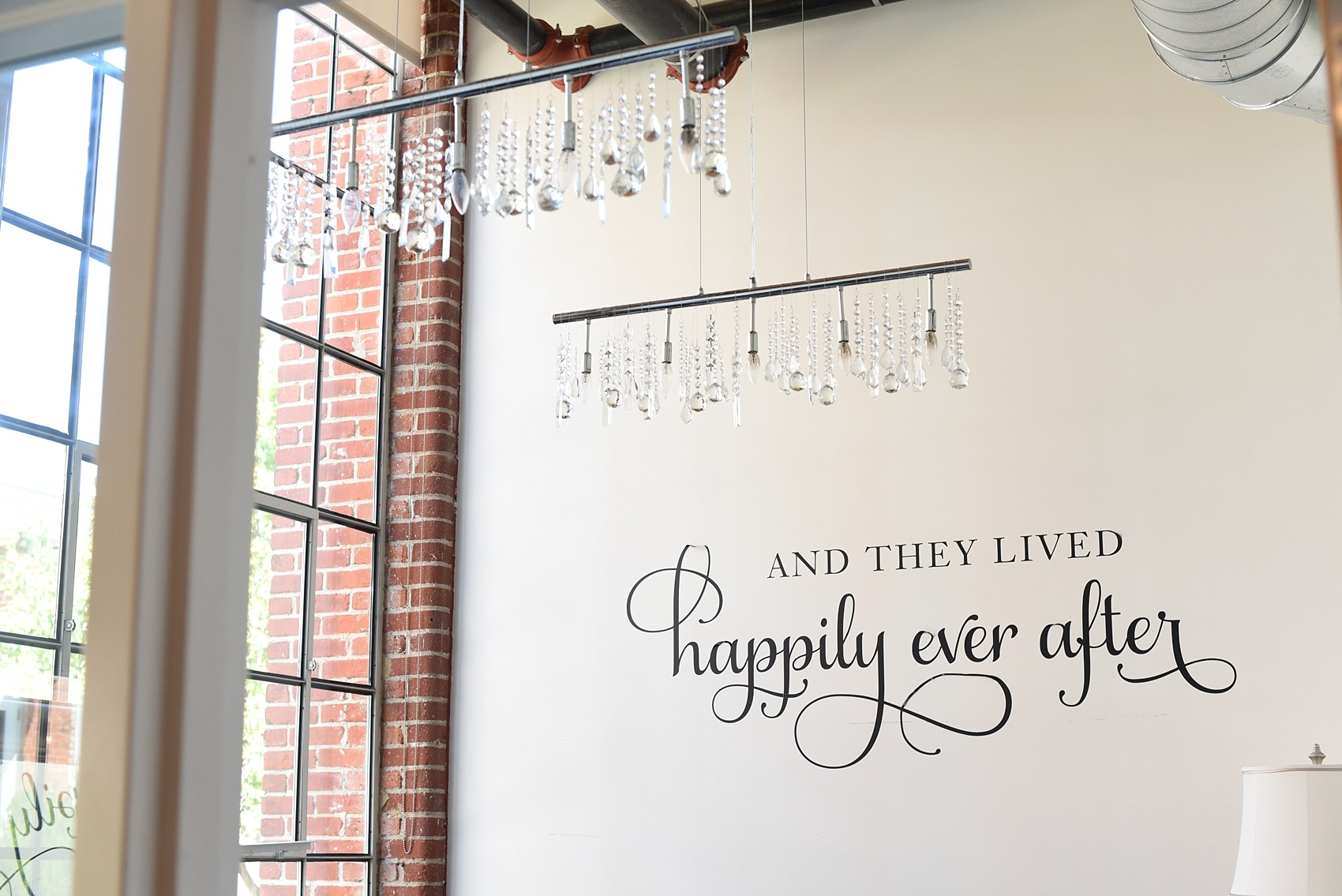 Mikkel Paige Photography photos from The Cotton Room wedding venue in Durham, NC. A Happily Ever After decal adorns the bridal suite wall.