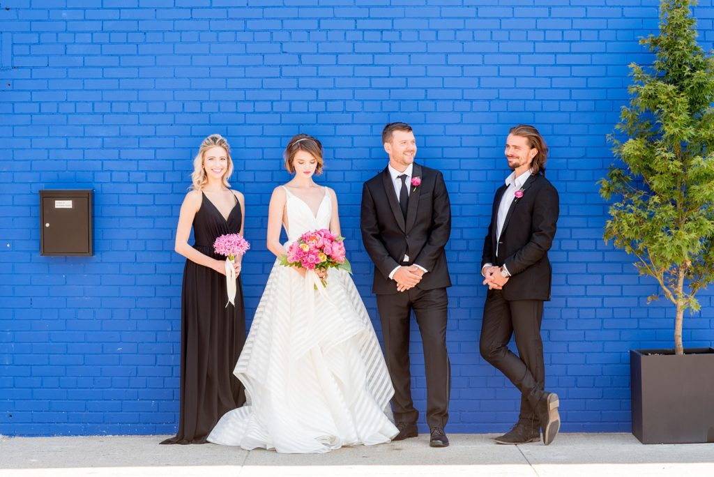 Mikkel Paige Photography photo of Dobbin St Brooklyn wedding. Striped white gown by Hayley Paige and pink peony bouquet. Planning and coordination by Color Pop Events.