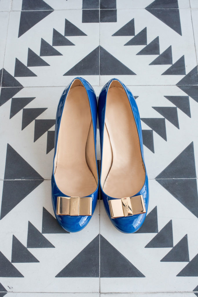 Mikkel Paige Photography photo of Dobbin St Brooklyn wedding. Blue Kate Spade shoes for the bride with planning and coordination by Color Pop Events.