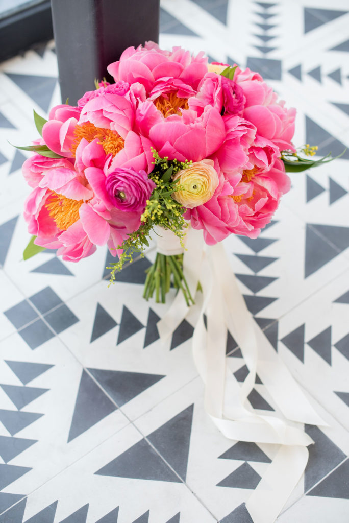 Mikkel Paige Photography photo of Dobbin St Brooklyn wedding. Planning and coordination by Color Pop Events with a peony and ranunculus bouquet by Blade NYC.