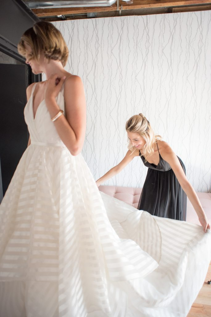 Mikkel Paige Photography photo of Dobbin St Brooklyn wedding. Planning and coordination by Color Pop Events with a striped white Hayley Paige gown.
