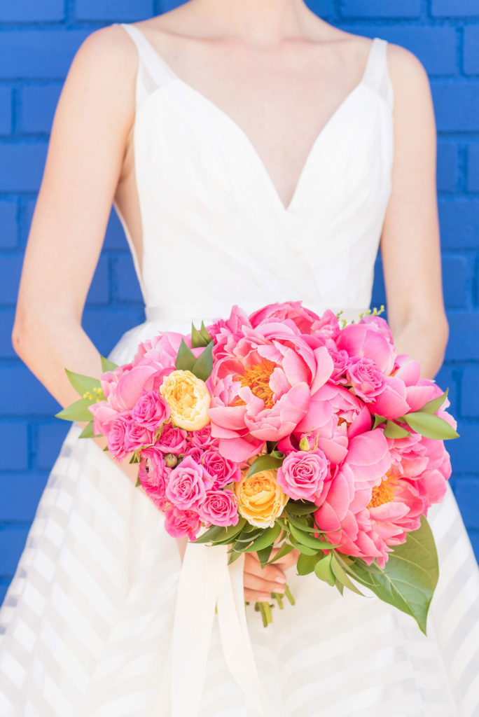 Mikkel Paige Photography photo of Dobbin St Brooklyn wedding. Planning and coordination by Color Pop Events with a peony and ranunculus bouquet by Blade NYC and striped white gown by Hayley Paige.