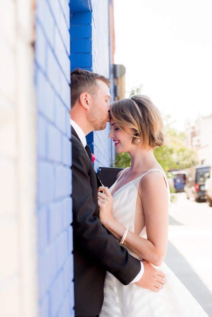 Mikkel Paige Photography photo of Dobbin St Brooklyn wedding. Planning and coordination by Color Pop Events. White striped gown by Hayley Paige.