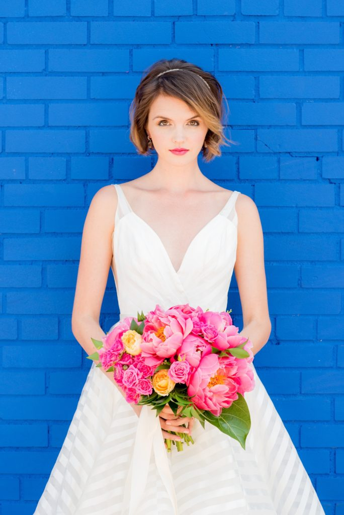 Mikkel Paige Photography photo of Dobbin St Brooklyn wedding. Planning and coordination by Color Pop Events. Bride in Hayley Paige white striped gown with short hair do with headband detail. Peony and ranunculus bouquet by Blade NYC.