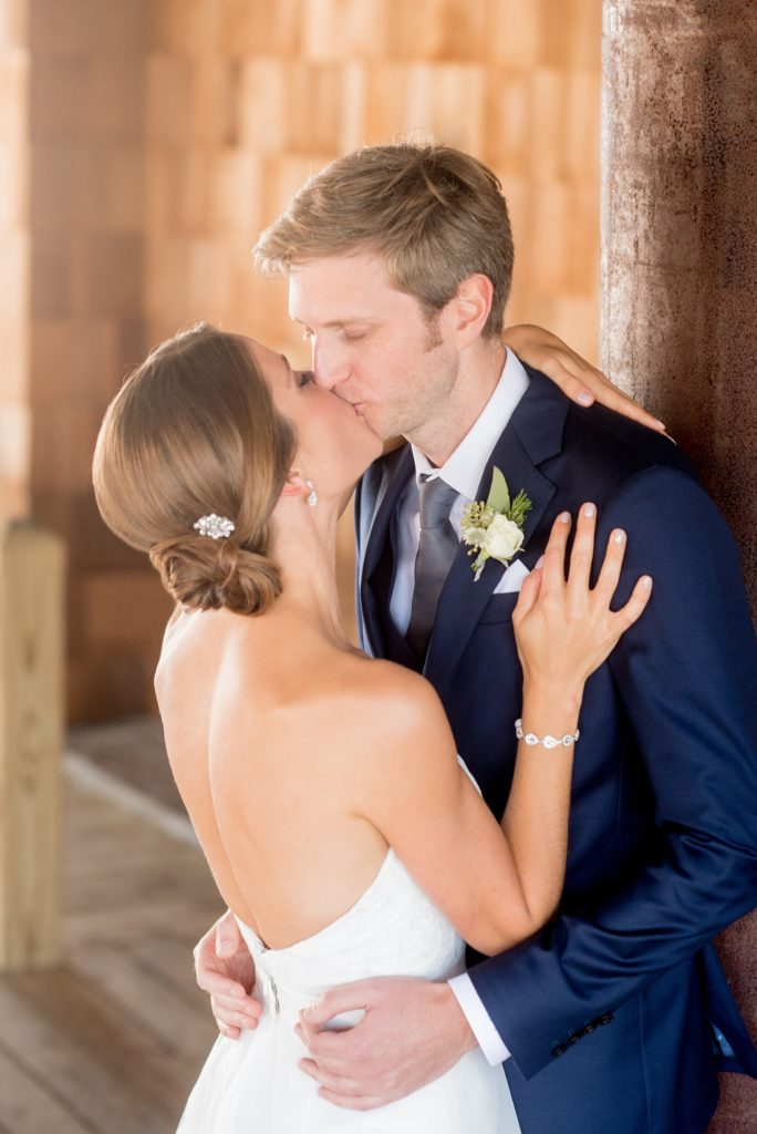 Mikkel Paige Photography photos from a Bay Head Yacht Club wedding in NJ. The bride and groom share a kiss.