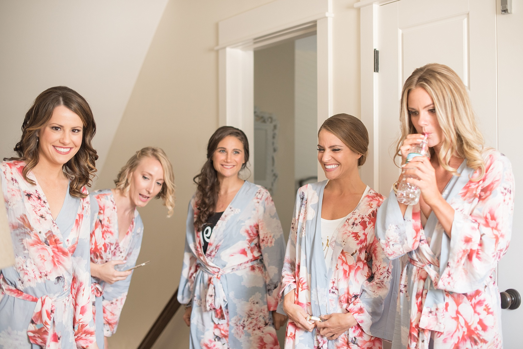 Mikkel Paige Photography photos from a Bay Head Yacht Club wedding in NJ. The bride and her bridesmaids got ready in blue and peach floral robes.