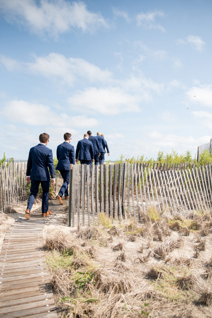 Mikkel Paige Photography photos from a Bay Head wedding in NJ. The groomsmen head to the beach for a nautical themed day at the yacht club.