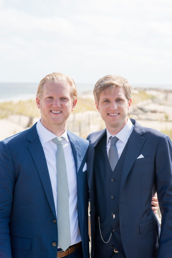 Mikkel Paige Photography photos from a Bay Head wedding in NJ. The groom and his best man posed for a photo on the beach for a nautical themed day at the yacht club.
