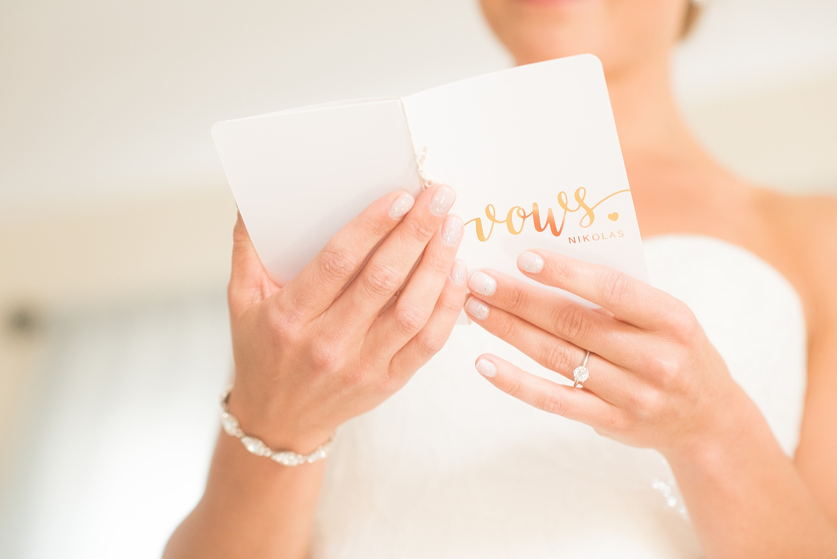 Mikkel Paige Photography photos from a nautical wedding at Bay Head Yacht Club in NJ. The bride and groom had silver and white customized vow books.