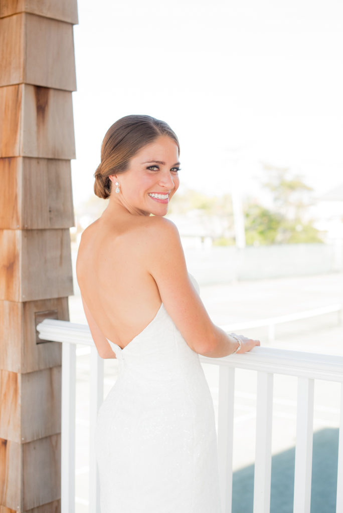 Mikkel Paige Photography photos of a Bay Head Yacht Club nautical wedding. The bride wore a low back sweetheart neckline gown.