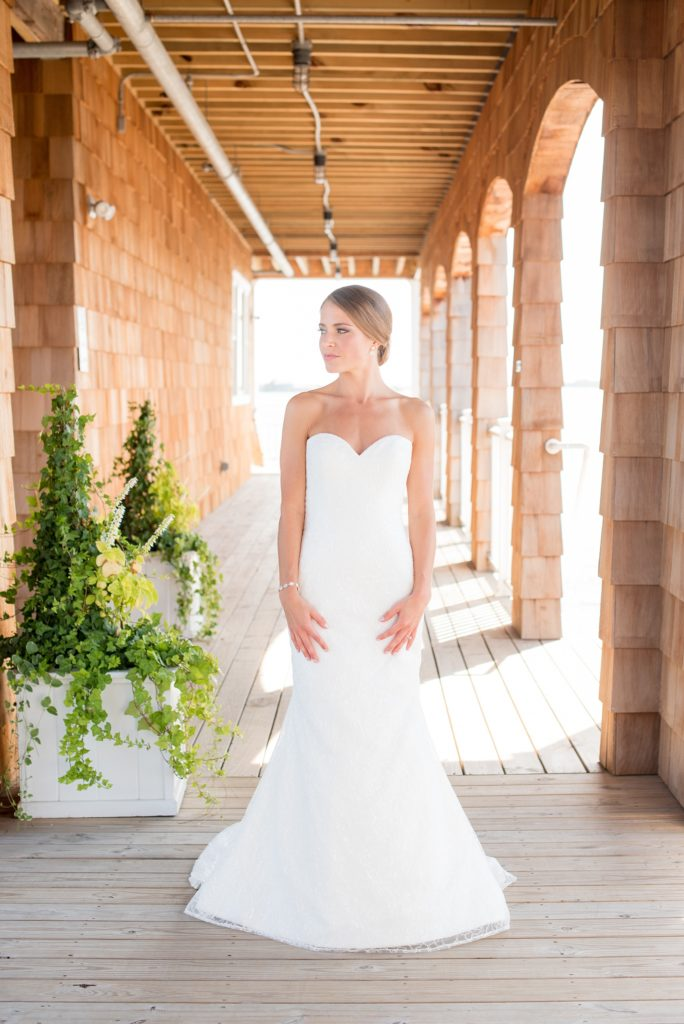 Mikkel Paige Photography photos of a Bay Head Yacht Club nautical wedding. The bride wore a low back sweetheart neckline gown from Kleinfeld and a low bun hari do.