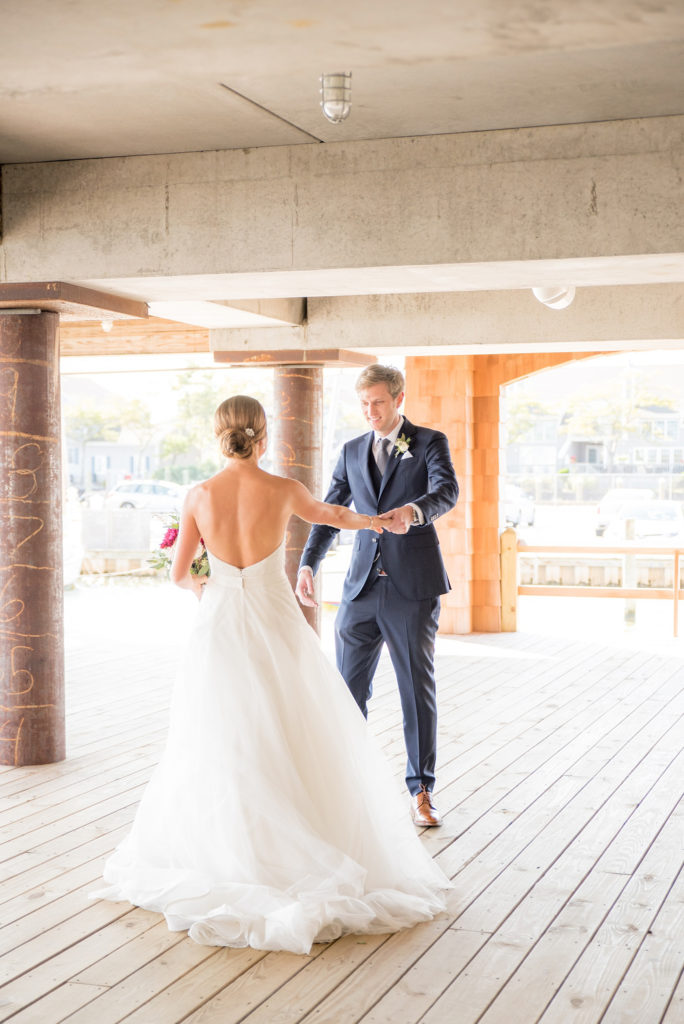 Mikkel Paige Photography photos of a Bay Head Yacht Club nautical wedding. The bride and groom share their first look.