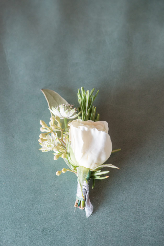 Mikkel Paige Photography photos of a Bay Head Yacht Club nautical wedding. The groom wore a white rose and rosemary boutonniere.