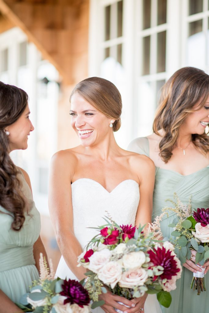 Mikkel Paige Photography photos of a Bay Head Yacht Club nautical wedding. The bride wore a white sweetheart gown and her bridesmaids wore mint green Amsale gowns.