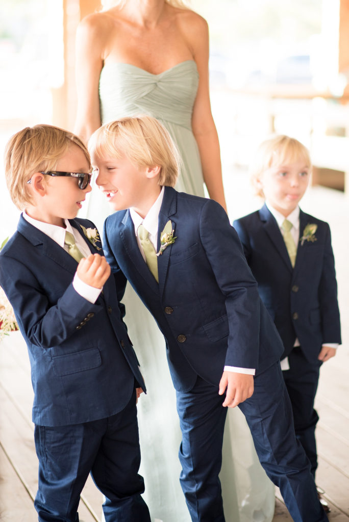 Mikkel Paige Photography photos of a Bay Head Yacht Club nautical wedding. The ring bearers wore navy blue suits with mini boutonnieres.