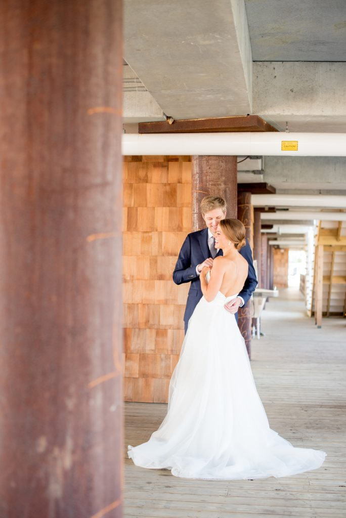 Mikkel Paige Photography photos of a Bay Head Yacht Club nautical wedding. The bride wore a white low back gown with lace and white sequins from Kleinfeld bridal.