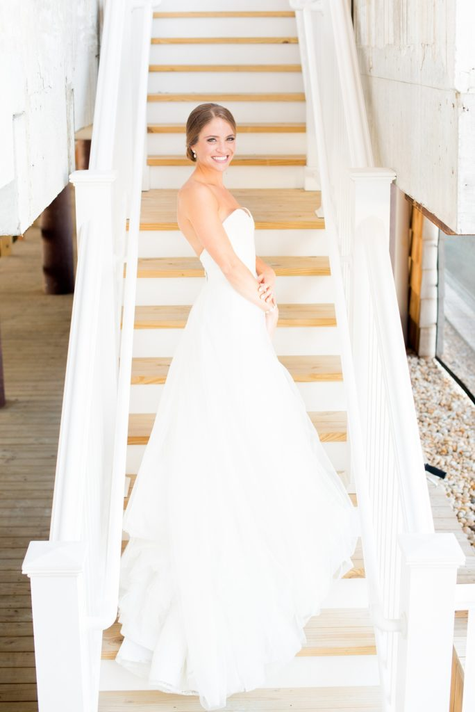 Mikkel Paige Photography photos of a Bay Head Yacht Club nautical wedding. The bride wore a white sweetheart neckline gown with lace and white sequins from Kleinfeld bridal.